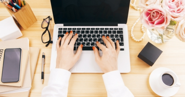 Start and Grow a Health Coach Email Newsletter. Female hands typing on a laptop.